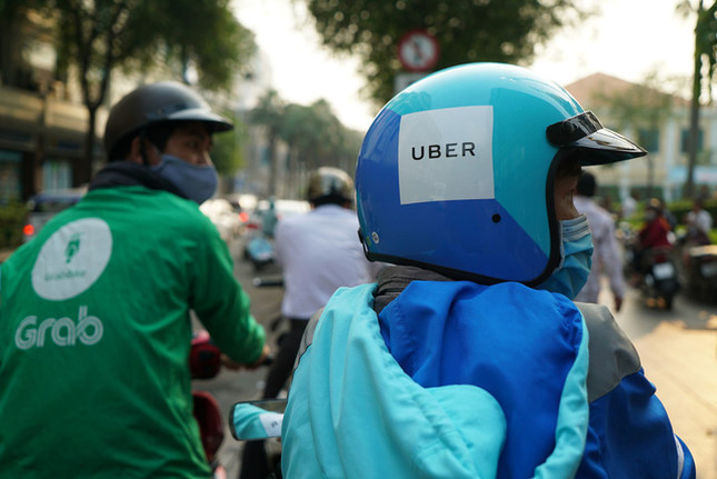 Thương vụ Grab mua lại Uber: Có dấu hiệu vi phạm Luật Cạnh tranh