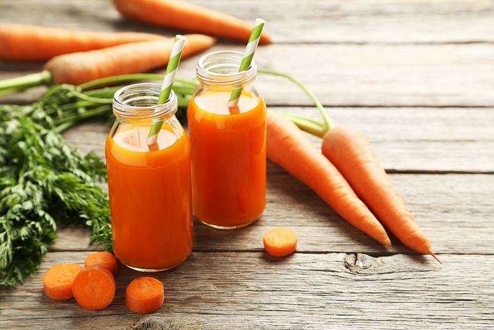 Lợi ích của việc uống nước ép cà rốt thường xuyên